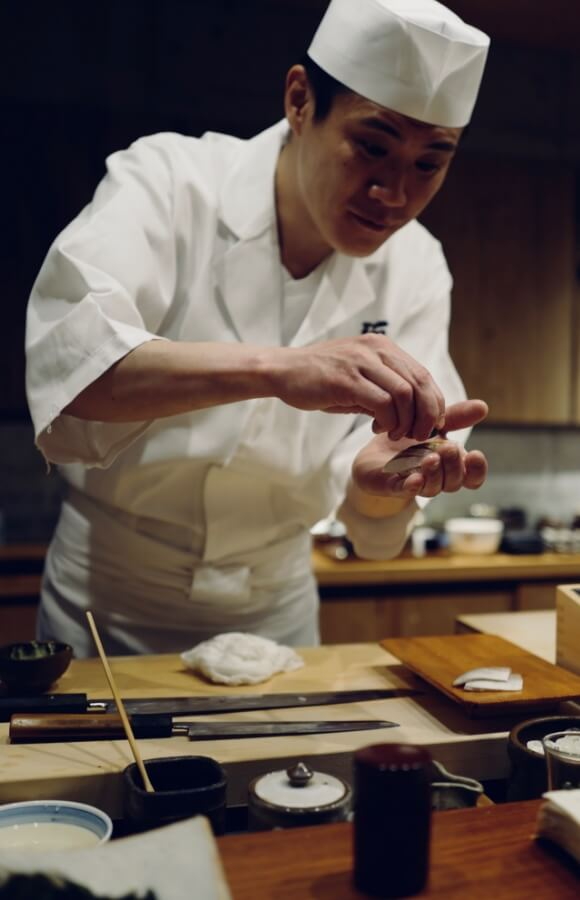 sushi chef preparing a perfect sushi in Japan