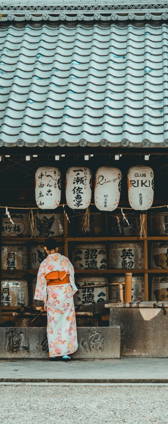 Geisha in front of a shrine in Japan